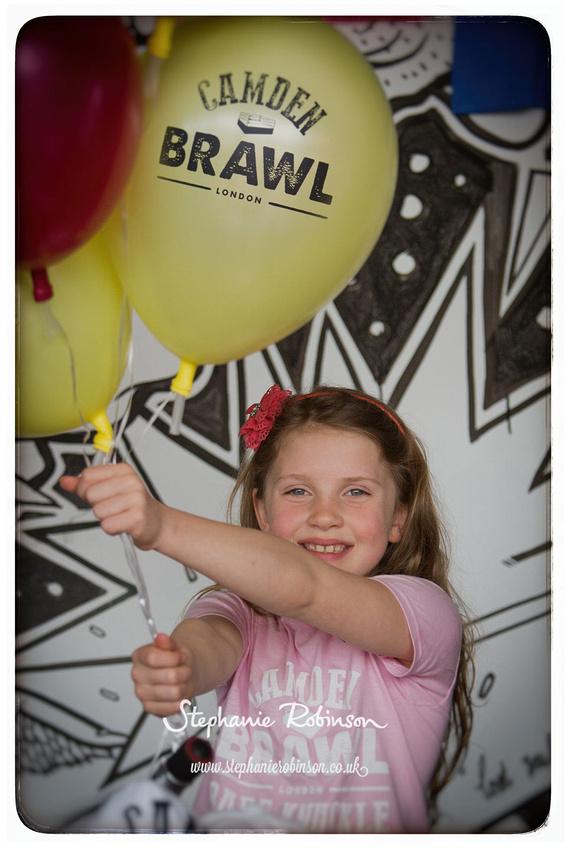 Camden Brawl girl holding balloons