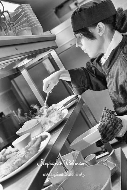 Chef Serving Food in Restaurant