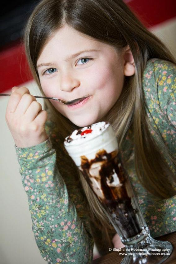 Girl eating Ice Cream Sundae