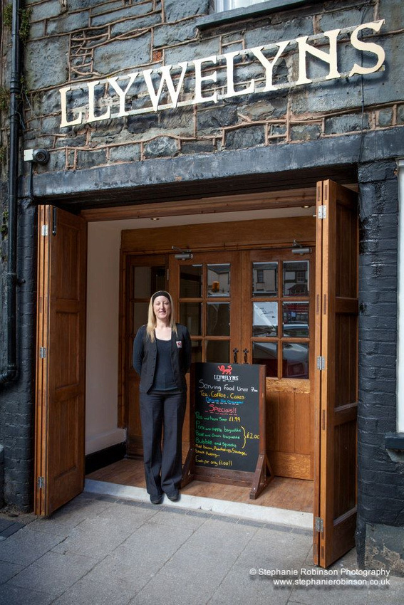Llywelyns Cafe Bar Bistro entrance and Manageress